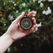 Woman holding compass to guide her mission